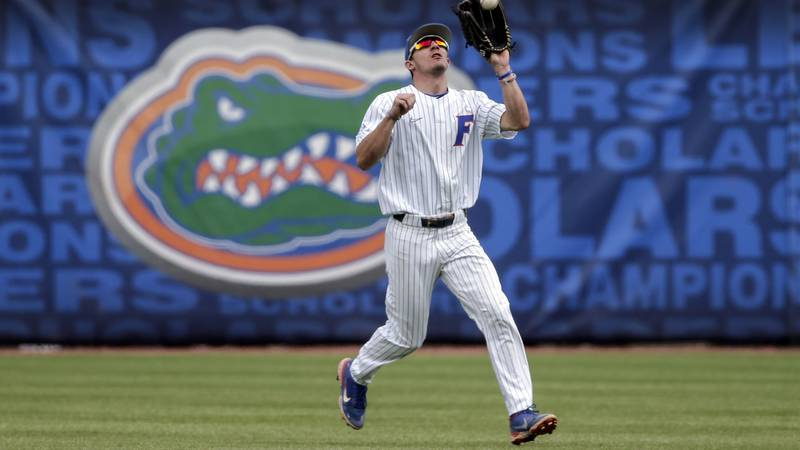 Florida outfielder Jacob Young catches a fly ball for an out on Tennessee's Max Ferguson in the...