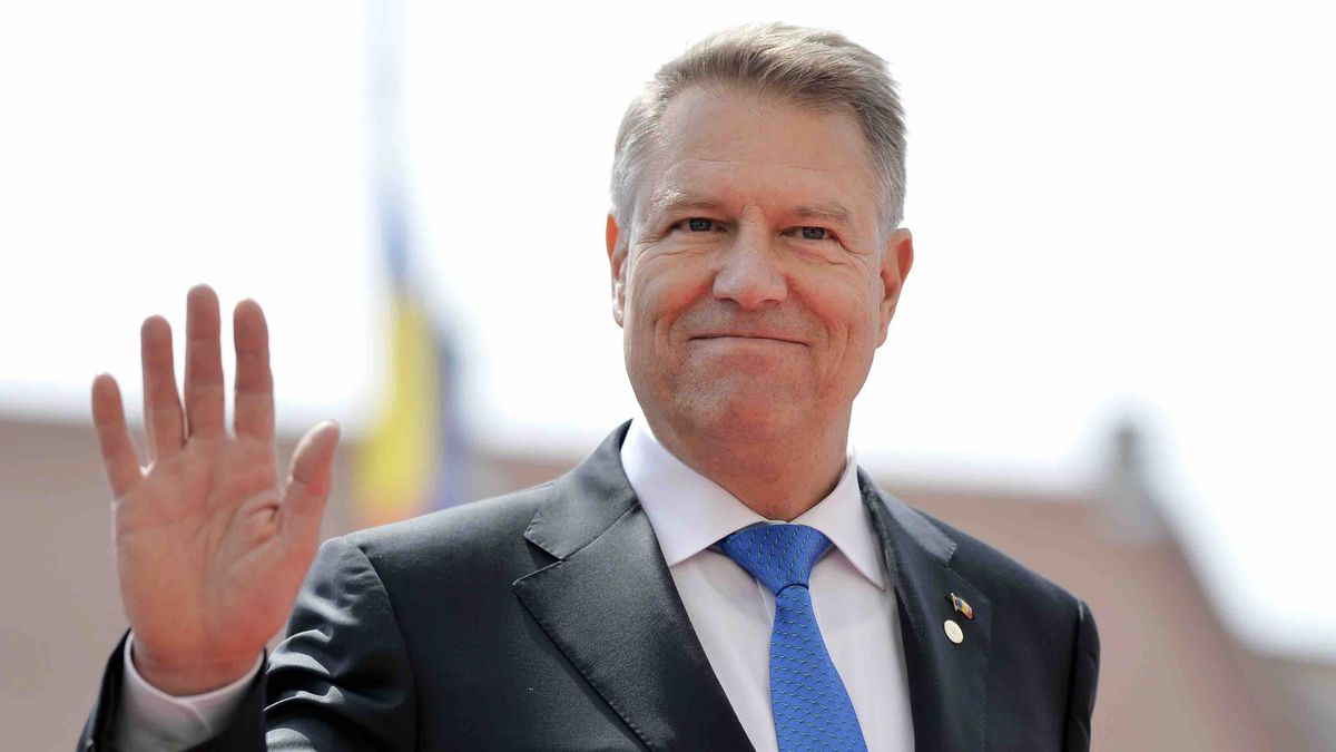 Romanian President Klaus Werner Ioannis waves as he arrives for an EU summit in Sibiu, Romania,...