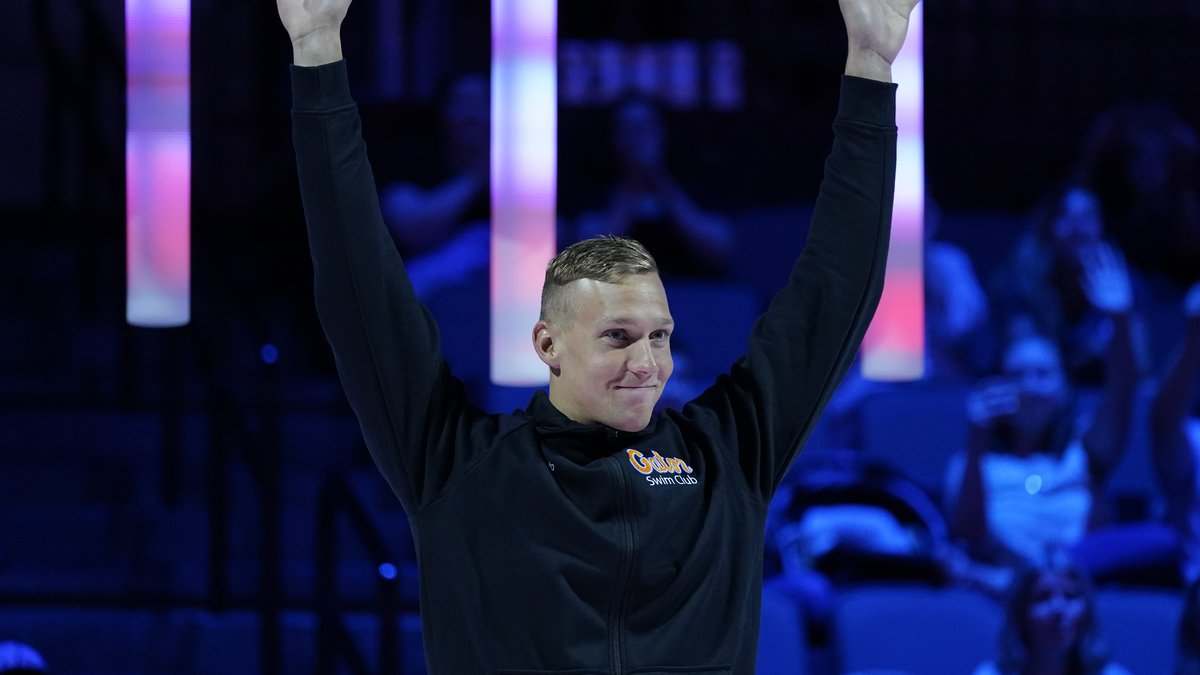 Caeleb Dressel reacts at the medal ceremony for the men's 50 freestyle during wave 2 of the...