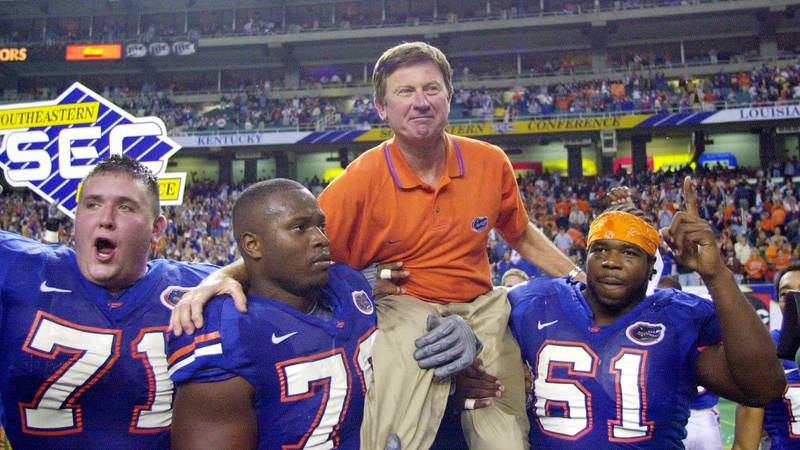 FILE - In this Dec. 2, 2000, file photo, Florida head coach Steve Spurrier is carried off the...