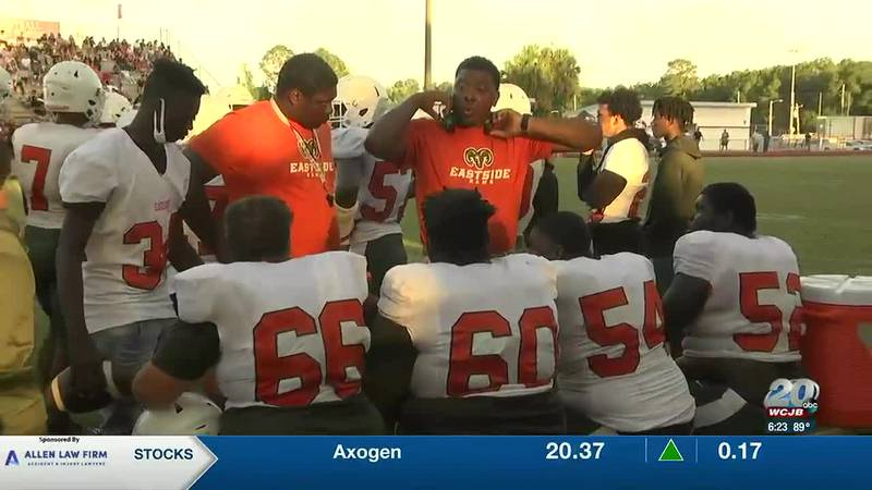 The Rams huddle up during a game with head coach Alex Deleon.