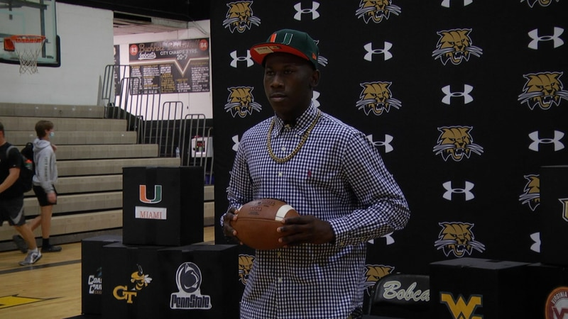 Buchholz receiver Quan Lee poses for a picture after announcing his decision to play football...