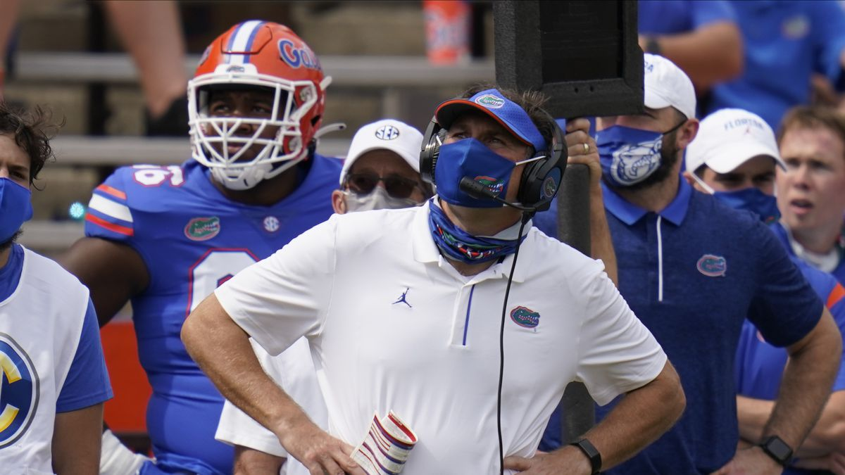 Florida head coach Dan Mullen looks at the scoreboard during the second half of an NCAA college...