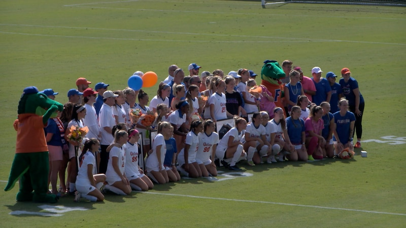 Florida soccer poses for a picture as the team celebrated Senior Day.