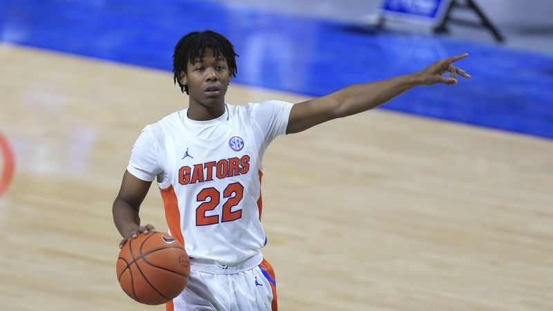 Florida guard Tyree Appleby (22) signals to teammates against South Carolina during the first...