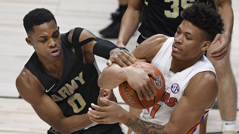 Army's Josh Caldwell, left, and Florida's Keyontae Johnson fight for possession of the ball in...