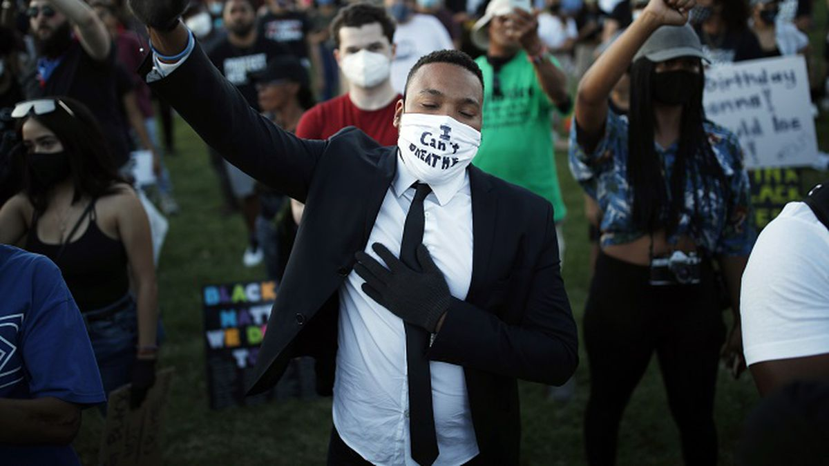 People raise their fists during a rally, Friday, June 5, 2020, in Las Vegas, against police brutality sparked by the death of George Floyd, a black man who died after being restrained by Minneapolis police officers on May 25. (Source: AP Photo/John Locher)