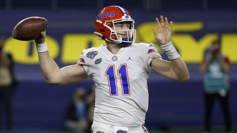 Florida quarterback Kyle Trask throws a pass during the first half of the team's Cotton Bowl...