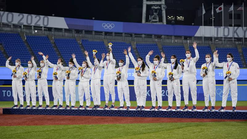 Silver medalist team United States celebrate on the podium during the medal ceremony for...