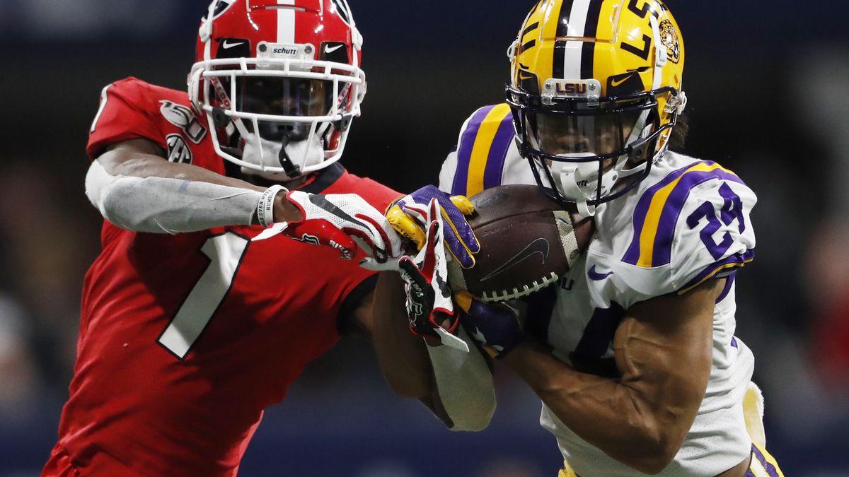 FILE - In this Dec. 7, 2019, file photo, LSU cornerback Derek Stingley Jr. (24) intercepts the...