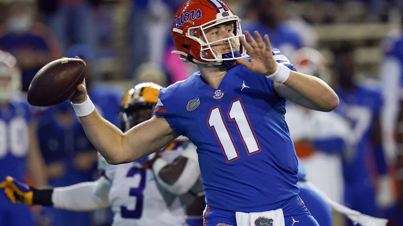 FILE - In this Dec. 12, 2020, file photo, Florida quarterback Kyle Trask (11) throws a pass...