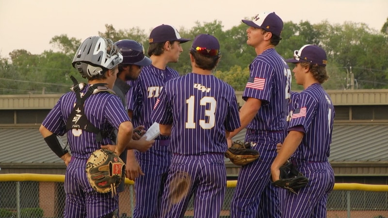 Union County infielders huddle around the mound during their game against P.K. Yonge Tuesday...