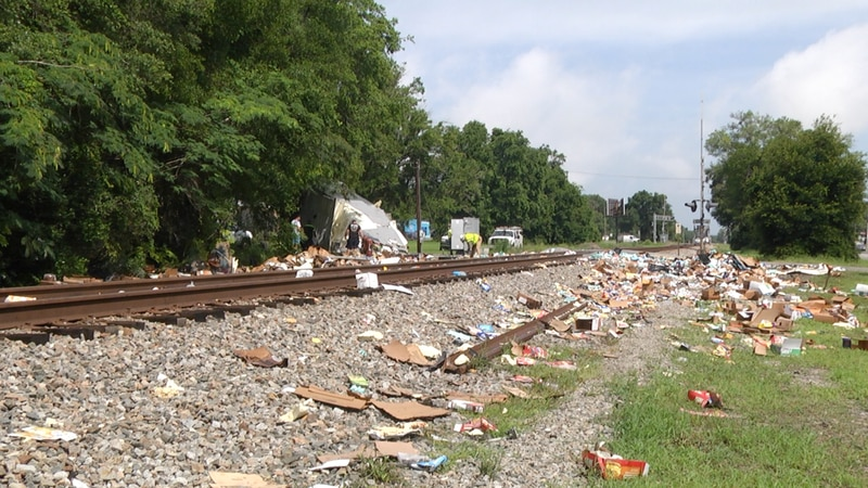 Crews from CSX Transportation worked much of the day picking up the pieces after one of their...