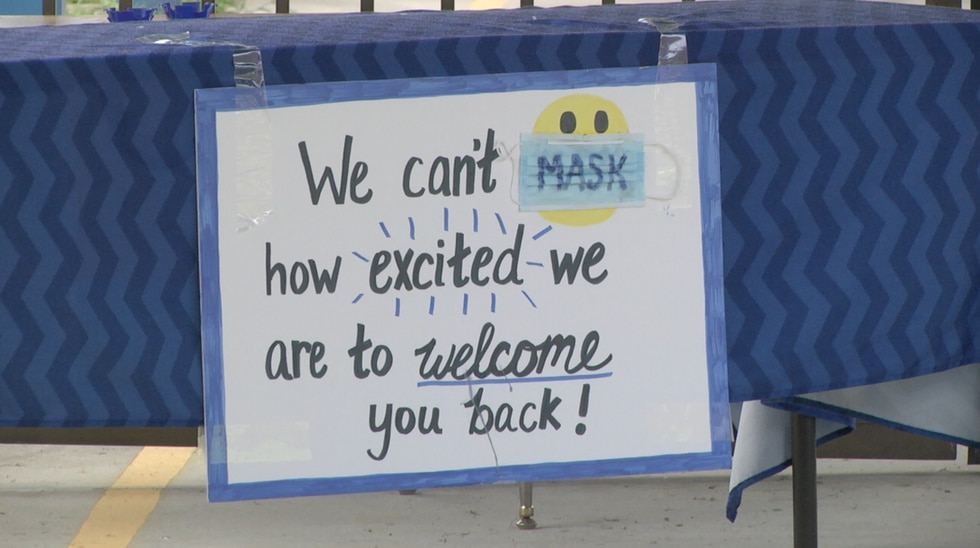 Welcome sign hangs outside for when students return.