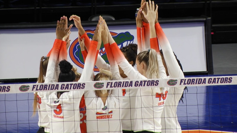 Gator players huddle up before their match with Arkansas Friday evening.