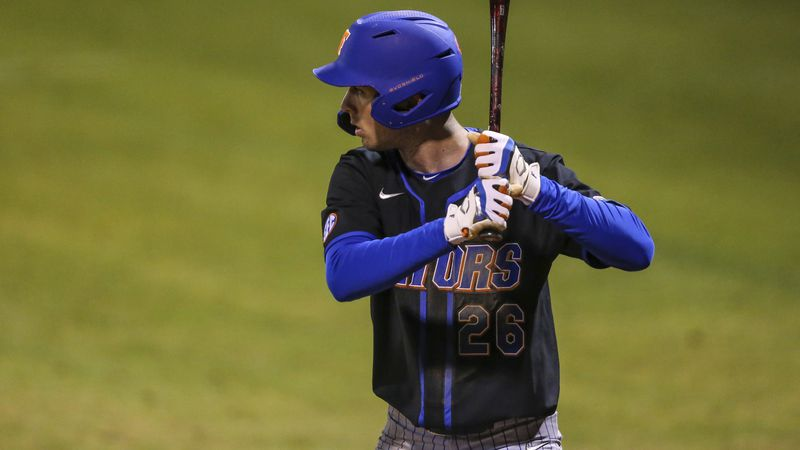 Florida infielder Sterlin Thompson (26) bats during an NCAA baseball game against North Florida...