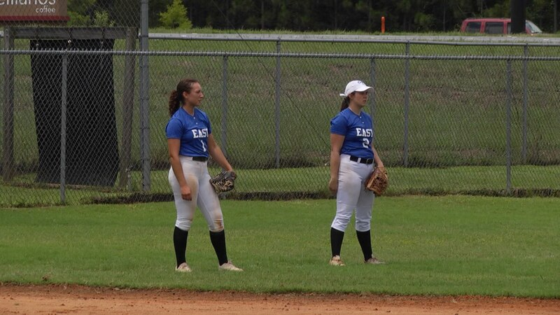 Team East players warm up before their second softball game of the North Florida All-Star...
