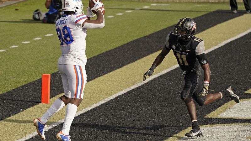 Florida tight end Kemore Gamble (88) catches a touchdown pass ahead of Vanderbilt safety Justin...