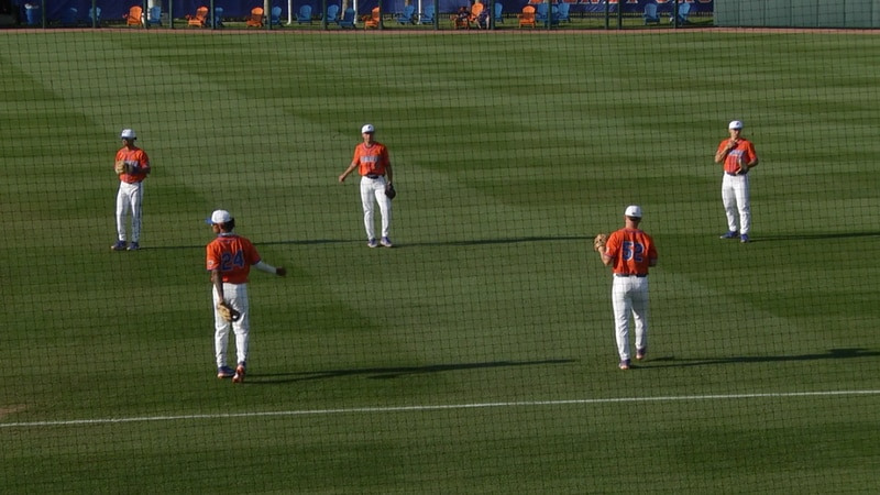 Florida players warm up before their game with FAMU Wednesday night.