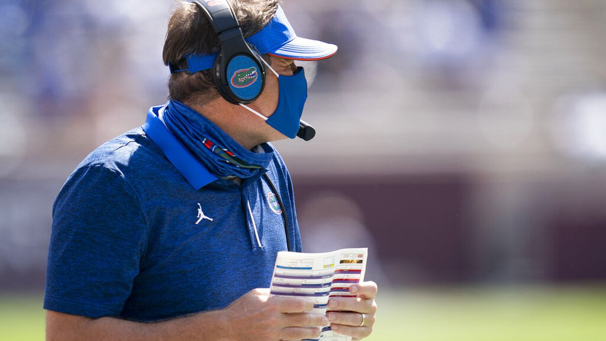 Florida head coach Dan Mullen calls to his offense before a snap against Texas A&M during the...