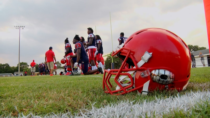 Vanguard Knights football players line up before their contest against the Buchholz Bobcats...