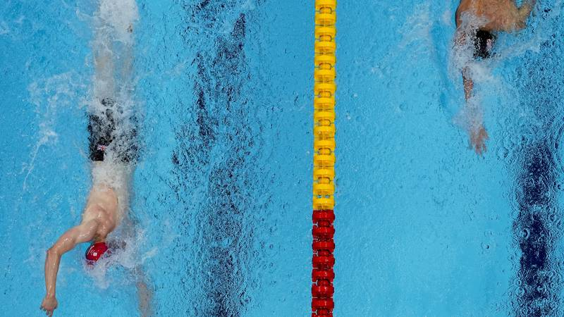 Tom Dean, of Britain and Kieran Smith, of the United States swim in the final of the men's...