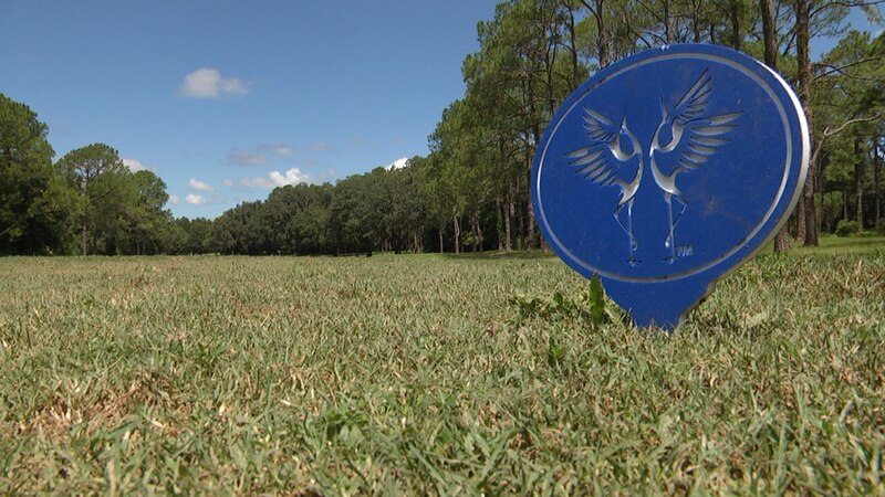 The tee marker on the second hole of Gainesville Country Club displays the G.C.C. logo.