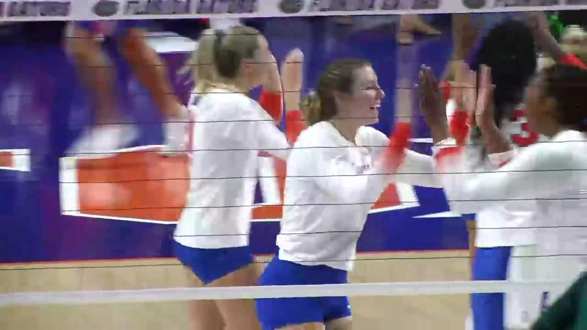 Florida celebrates winning a point during a match